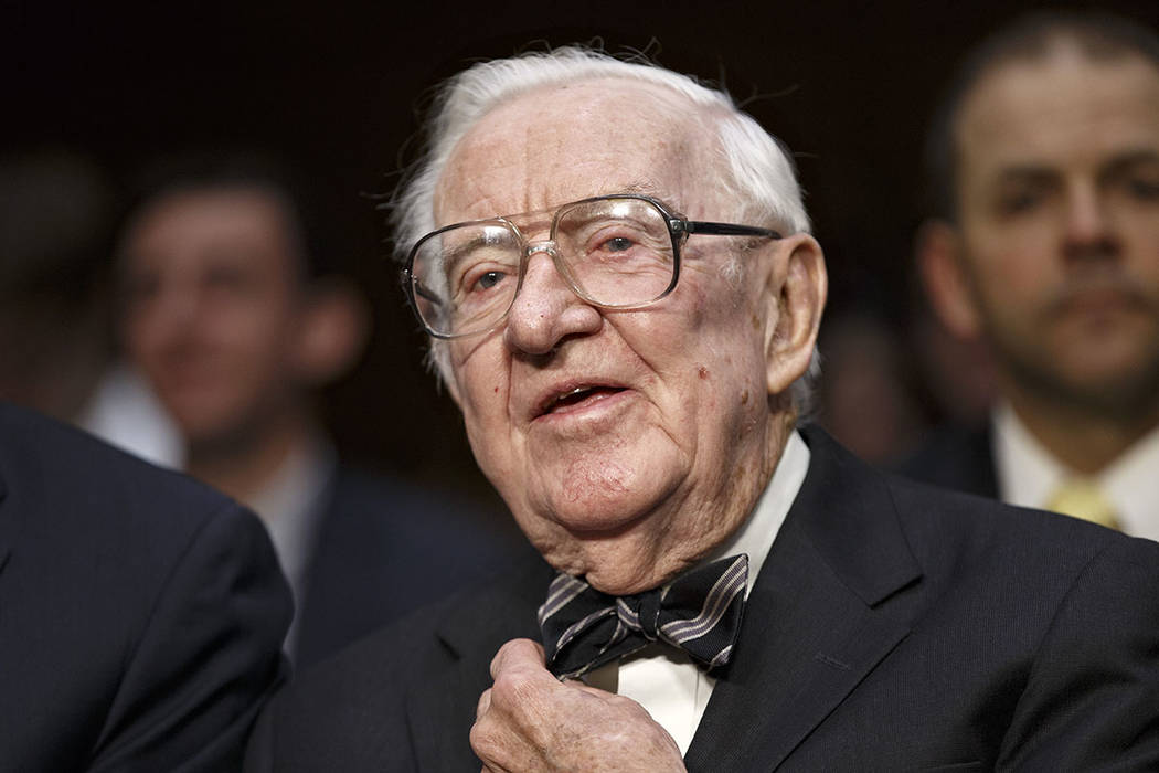 Retired Supreme Court Justice John Paul Stevens prepares to testify on the ever-increasing amou ...