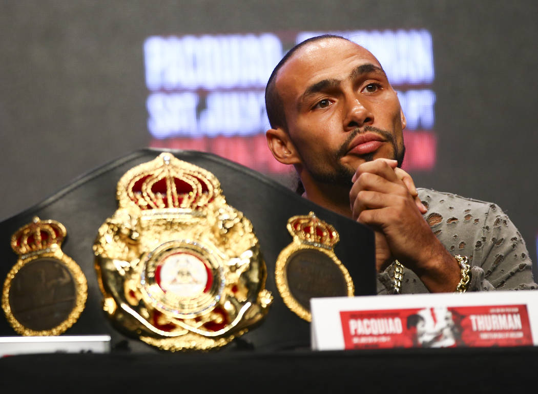 Keith Thurman listens during a press conference ahead of his WBA welterweight championship matc ...