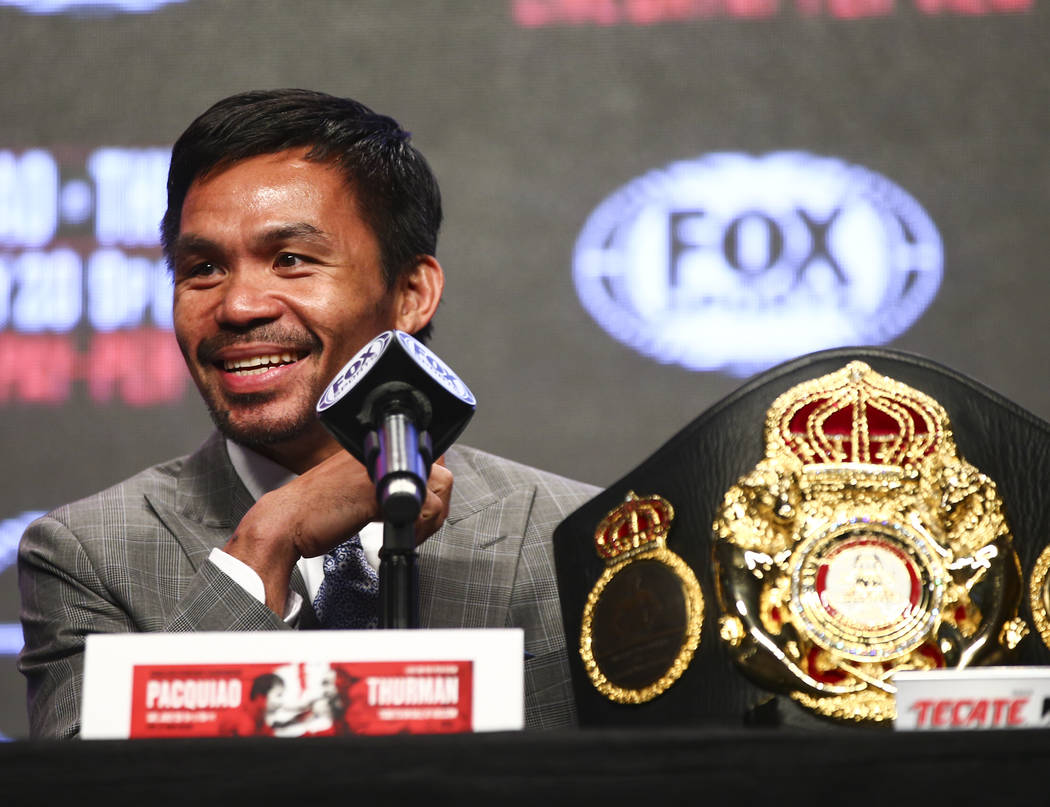Manny Pacquiao reacts while listening during a press conference ahead of his WBA welterweight c ...