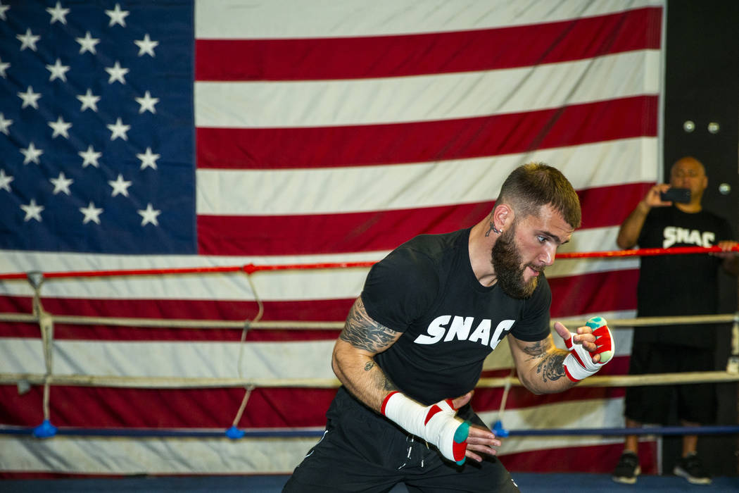 Boxer Caleb Plant, IBF super middleweight champion, warms up in the ring during a media day/ope ...