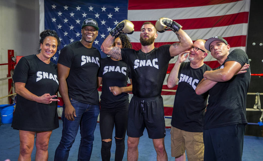 Boxer Caleb Plant, IBF super middleweight champion, center, jokes around during a team picture ...