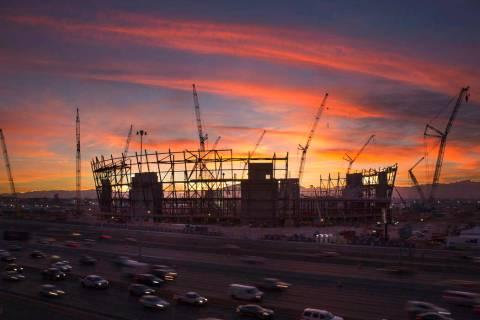 The sun sets behind the under-construction Las Vegas Stadium in Las Vegas on Wednesday, Dec. 19 ...