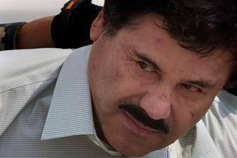 "In a Feb. 22, 2014, file photo, Joaquin ""El Chapo"" Guzman is escorted to a helicopter in handcu ..."