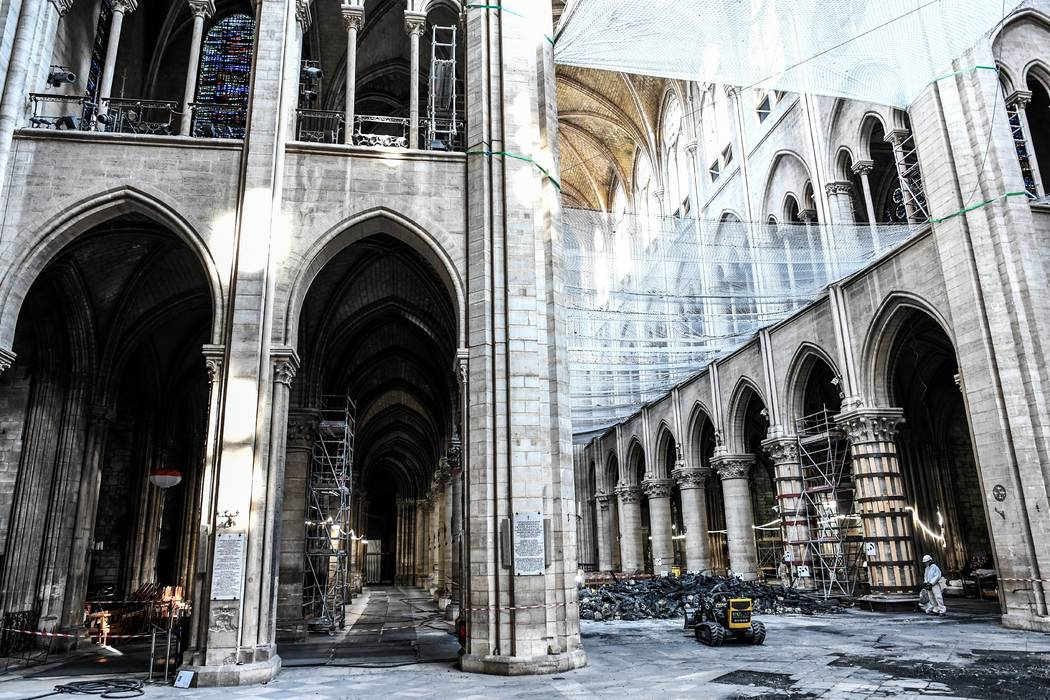 Damage on the nave and rubble during preliminary work are pictured in the Notre-Dame de Paris C ...