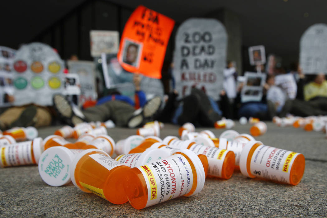 In an April 5, 2019, file photo, containers depicting OxyContin prescription pill bottles lie o ...