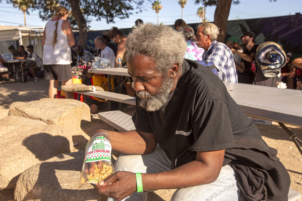 Allen Grayson, 60, from Bakersfield, Calif., eats popcorn before getting in line for a spot on ...