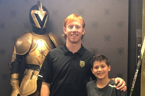 13-year-old Doron Coldwell with Golden Knights center Cody Eakin during his time with the team ...