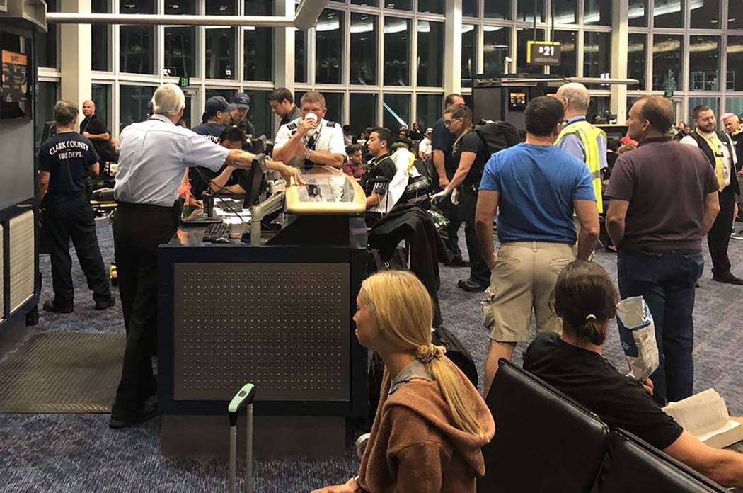 Clark County Fire Department crews respond to Terminal 1 to aid six people who complained of fu ...