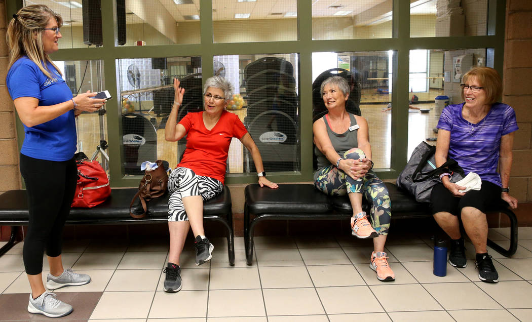 Anita Stephens, left, a SilverSneakers fitness instructor, talks to, from second from left, Ton ...