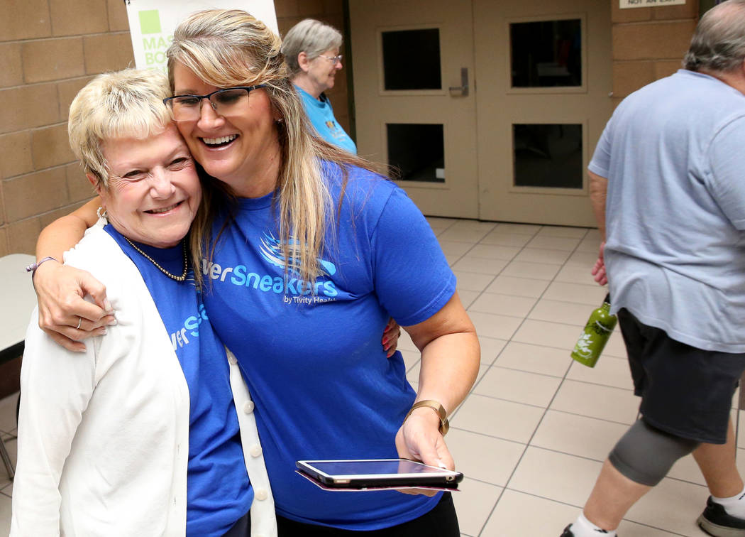 Anita Stephens, right, a SilverSneakers fitness instructor, greets Ellen Garland, 68, before cl ...