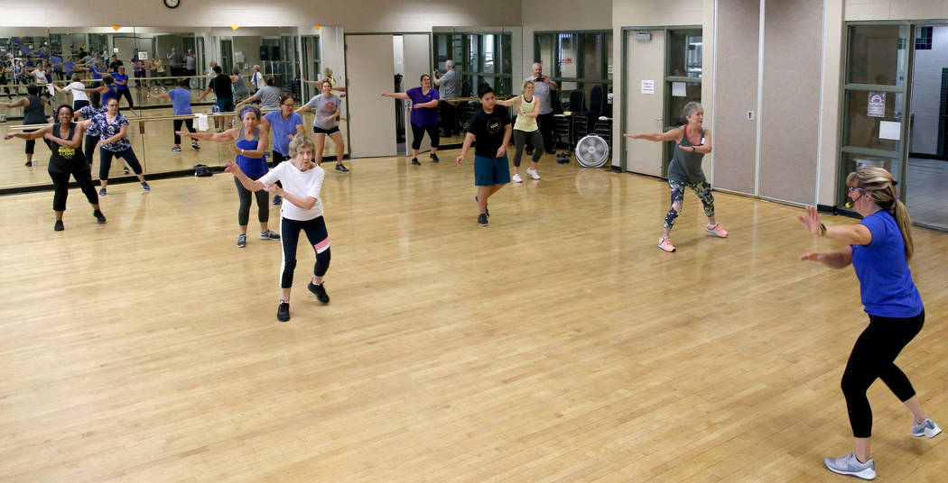 Anita Stephens, right, leads a STRONG by Zumba class as part of the SilverSneakers fitness prog ...