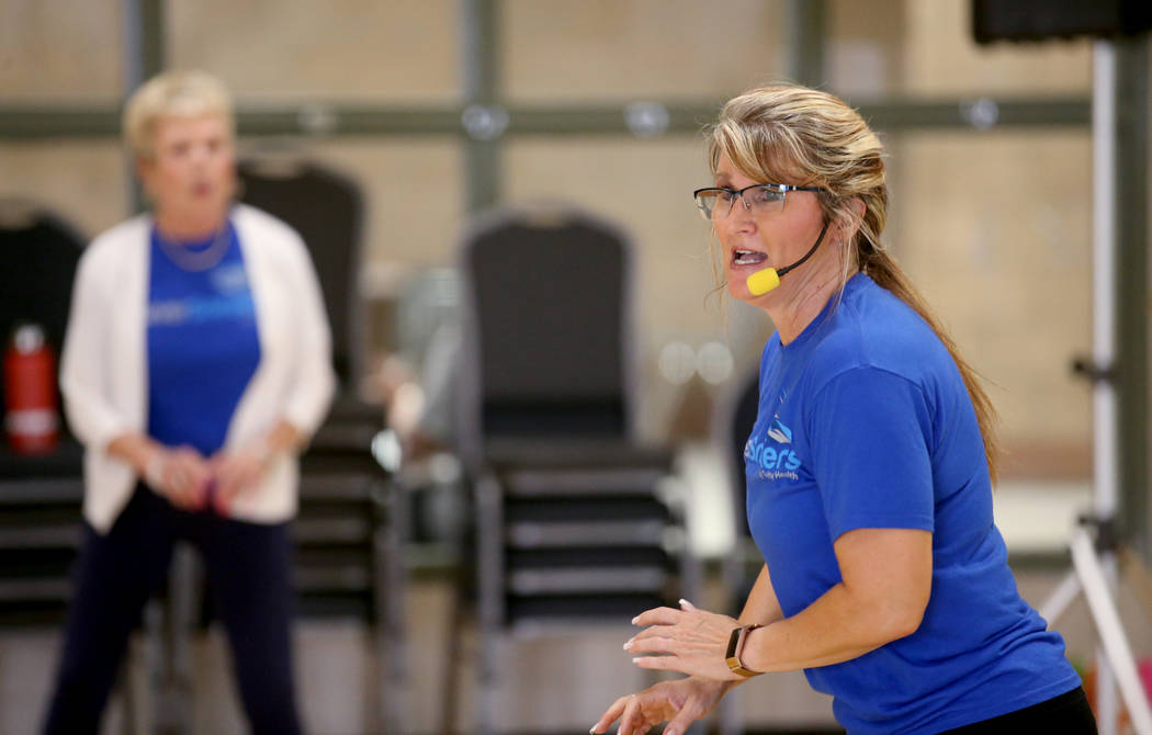 Anita Stephens leads a STRONG by Zumba class as part of the SilverSneakers fitness program at D ...