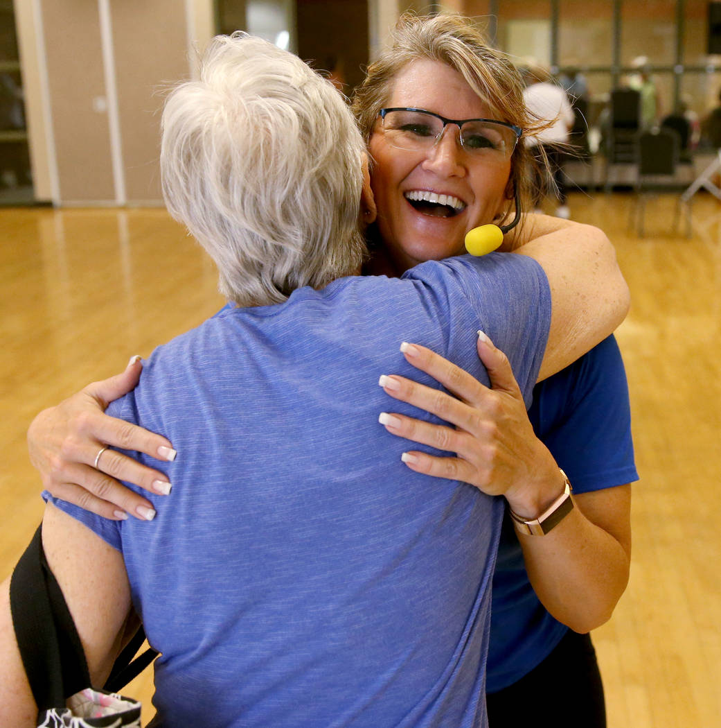 Anita Stephens, right, hugs Cindy Polito after STRONG by Zumba class as part of the SilverSneak ...