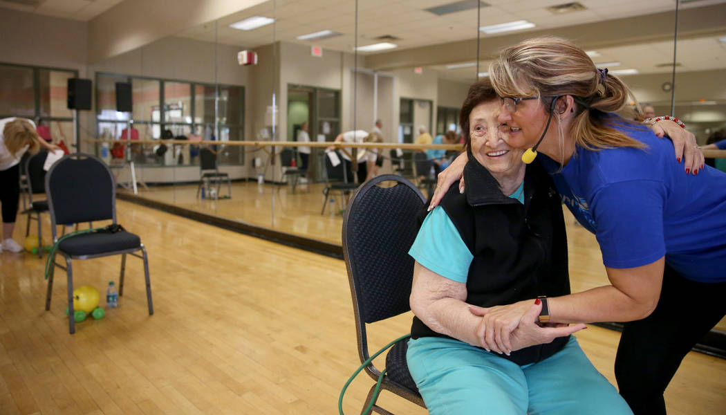 Anita Stephens, right, hugs Rachel Fried before a Body Flow class as part of the SilverSneakers ...