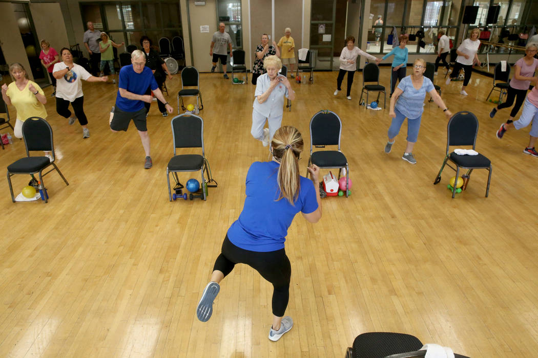 Anita Stephens teaches a Body Flow class as part of the SilverSneakers fitness program at Duran ...