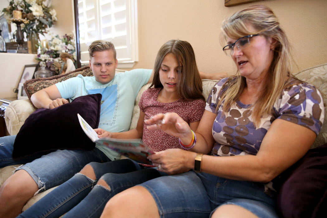 Anita Stephens, right, hangs out with son-in-law Trevor Phillips, 22, and adopted daughter Abi ...