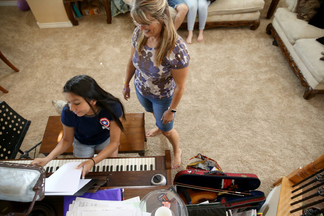 Anita Stephens, right, hangs out with adopted daughter Serra Stephens, 14, at their Las Vegas h ...