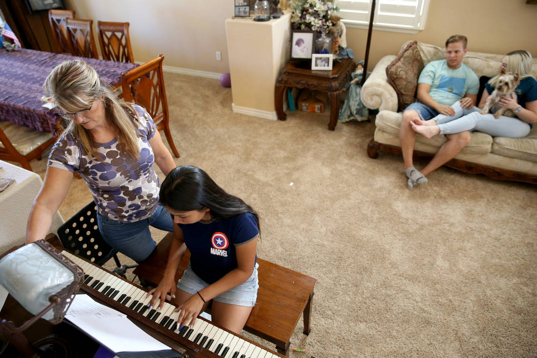 Anita Stephens, left, hangs out with adopted daughter Serra Stephens, 14, at their Las Vegas ho ...