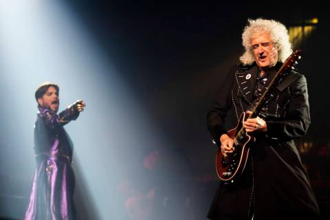 Adam Lambert and Queen guitarist Brian May perform at Park MGM theater in Las Vegas, Sept. 1, 2 ...