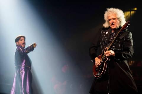 Adam Lambert and Queen guitarist Brian May perform at Park MGM theater in Las Vegas, Sept. 1, 2 ...