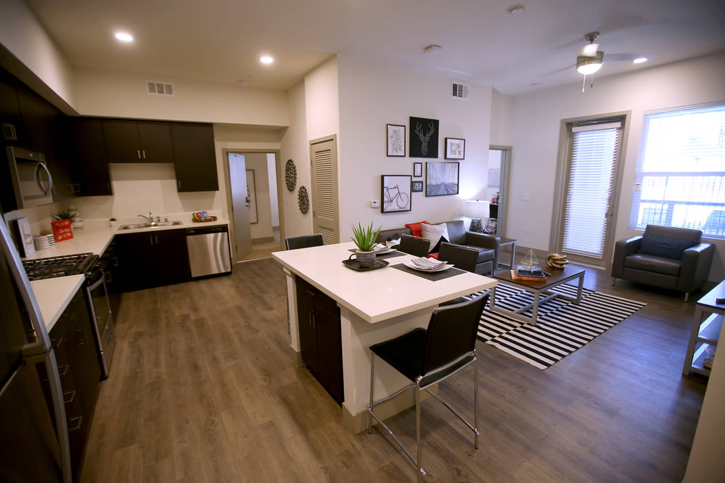 The common living area of a four-bedroom unit at The Degree, a recently-opened 226-unit on-camp ...