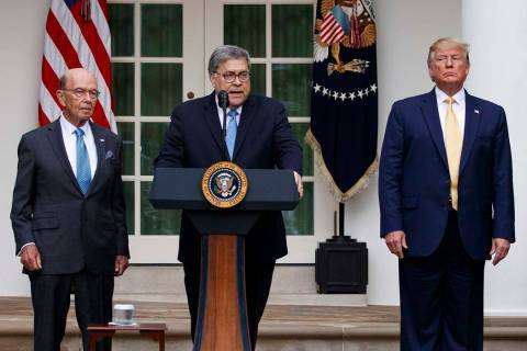 Attorney General William Barr speaks as he stands with Commerce Secretary Wilbur Ross, left, an ...