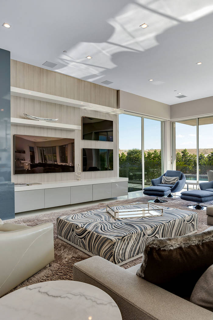 The great room has high ceilings and several large-screen TVs. (Ivan Sher Group)