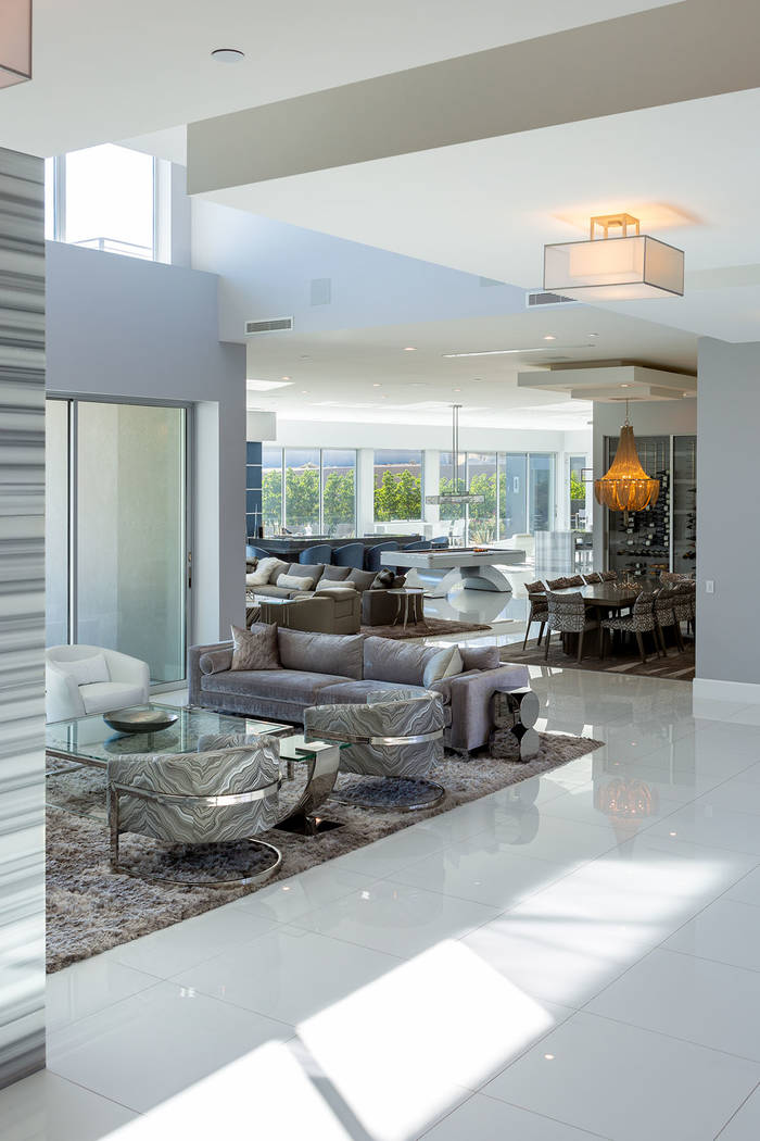 The home has an open floor plan and floor-to-ceiling windows. (Ivan Sher Group)