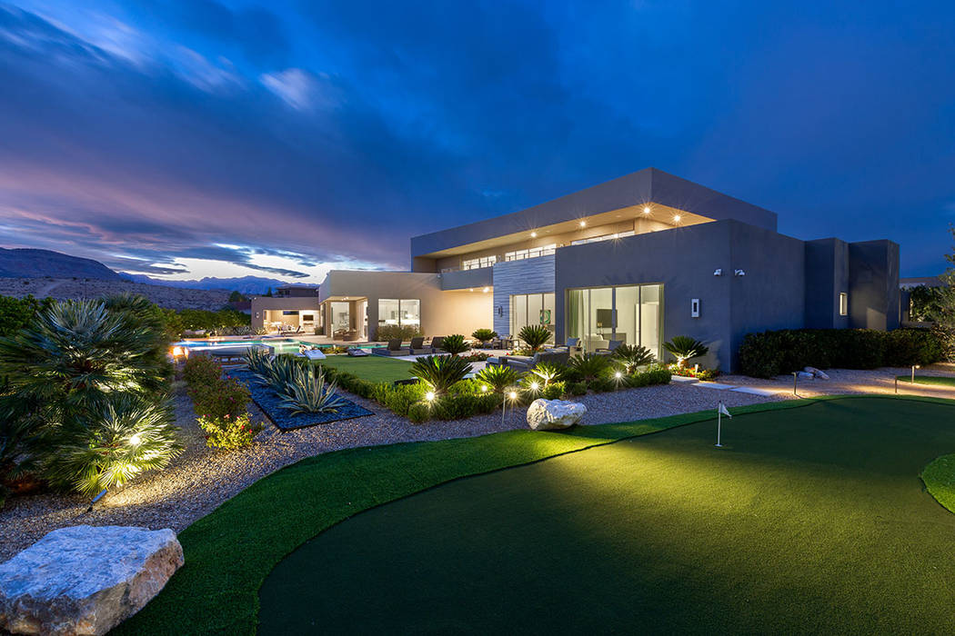 The custom residence features a putting green. (Ivan Sher Group)