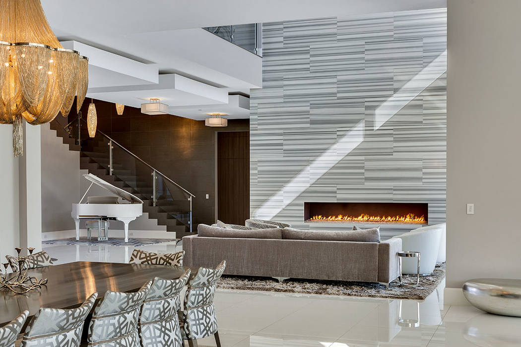 A focal point of the living area is the modern fireplace. (Ivan Sher Group)