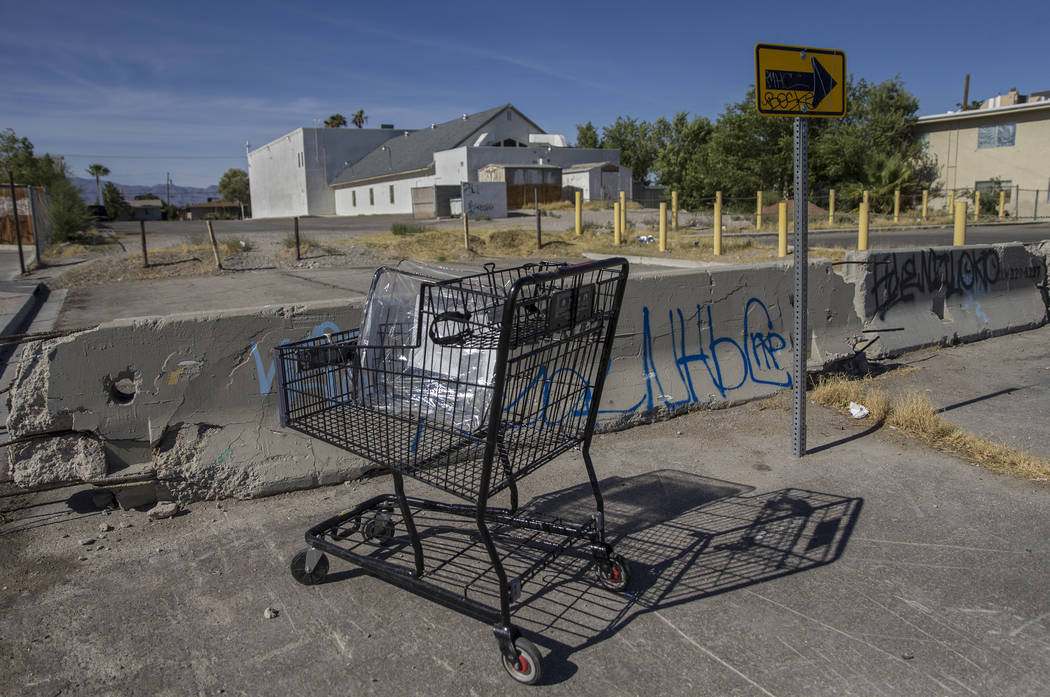 An abandoned shopping cart filled with trash at the intersection of West Warren Drive and North ...