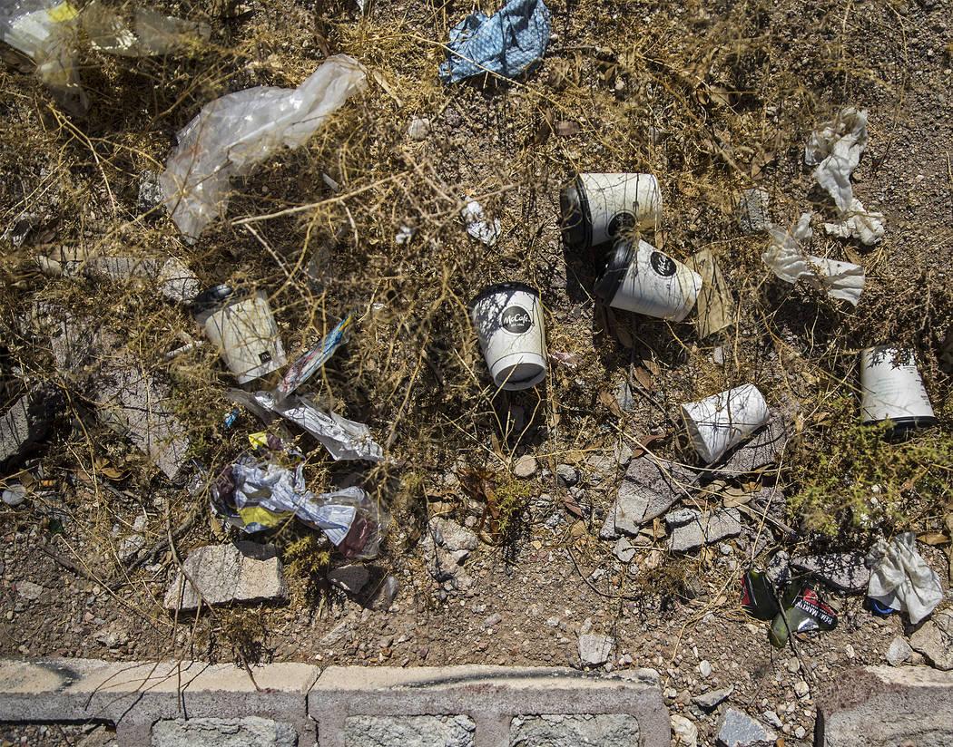 Trash piles up in a field on H Street near West Bonanza Road on Wednesday, July 17, 2019, in La ...