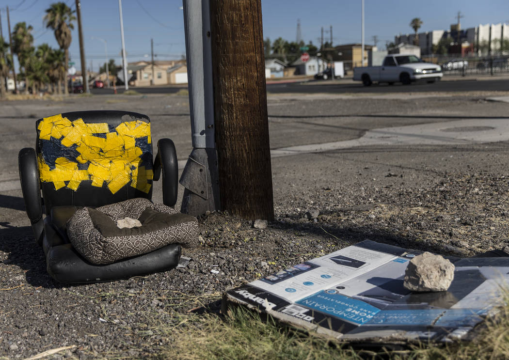Discarded furniture and empty boxes lay in a field close to the intersection of South Las Vegas ...