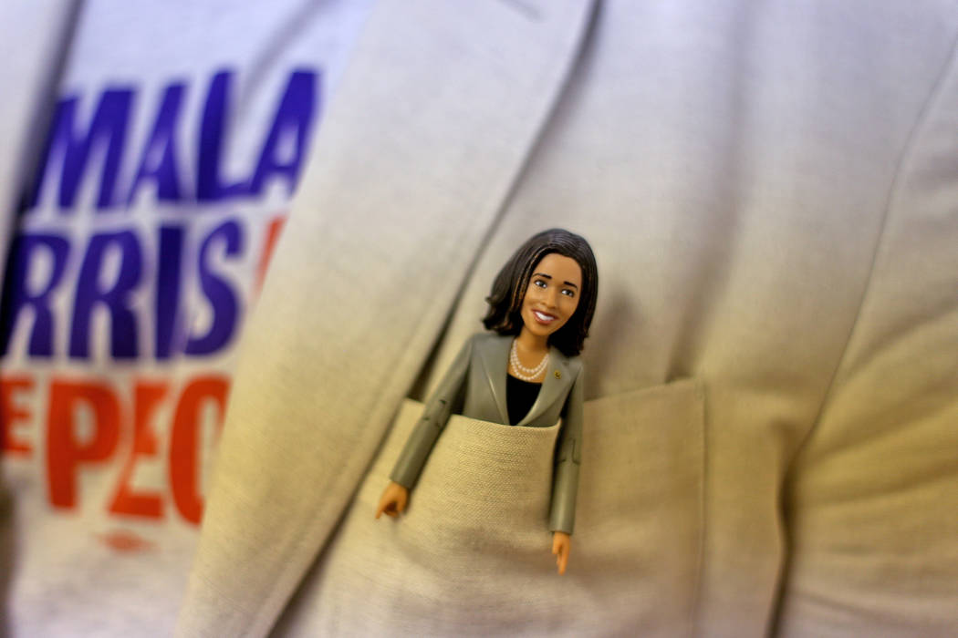 Chris Miller, the former chairman of the Nevada Democratic Party, shows off his Kamala Harris d ...