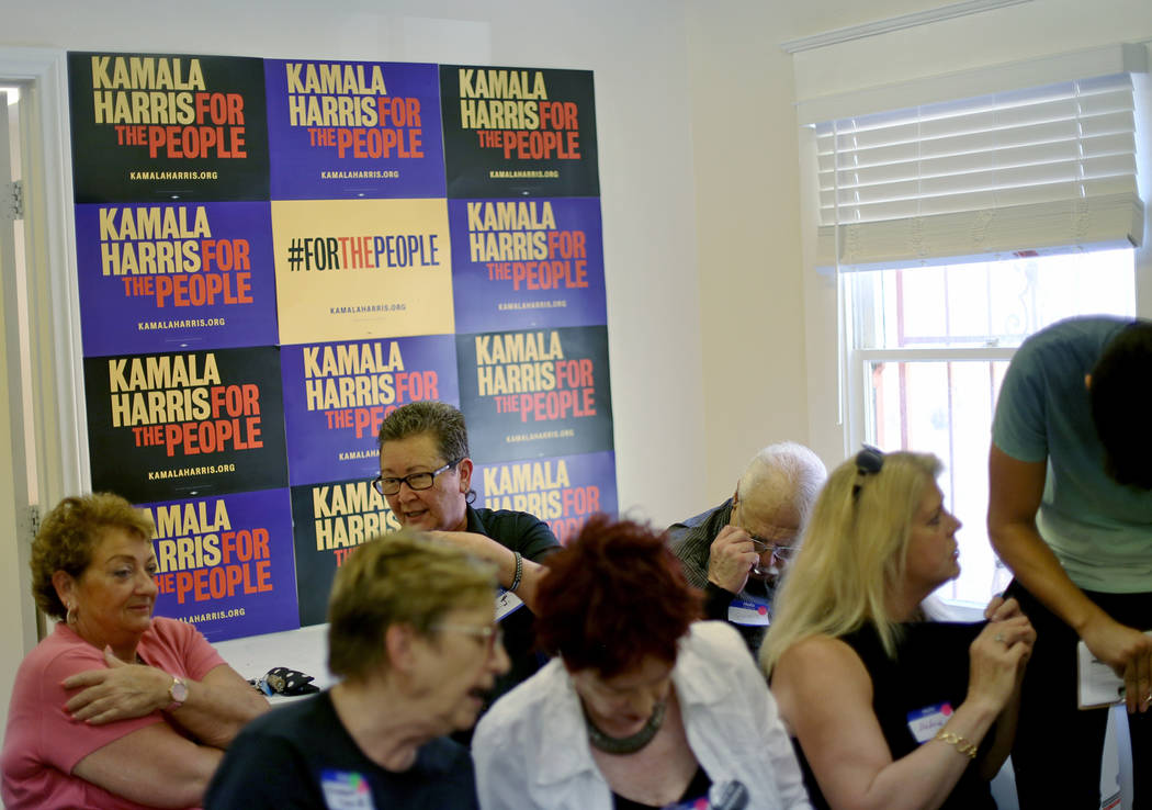 Guests socialize at a meet-n-greet with campaign staff at the new office for Kamala Harris' 202 ...