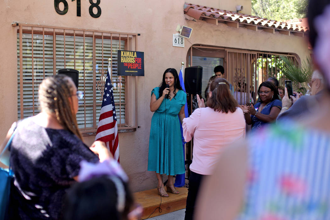 Rachel Pinto, a field organizer, addresses guests at a meet-n-greet with campaign staff at the ...
