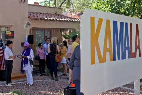 Guests socialize at the new office for Kamala Harris' 2020 presidential campaign in Las Vegas, ...