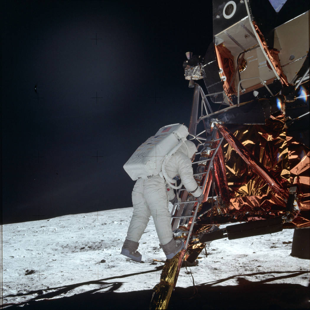 In this July 20, 1969 photo made available by NASA, astronaut Buzz Aldrin Jr. descends a ladder ...