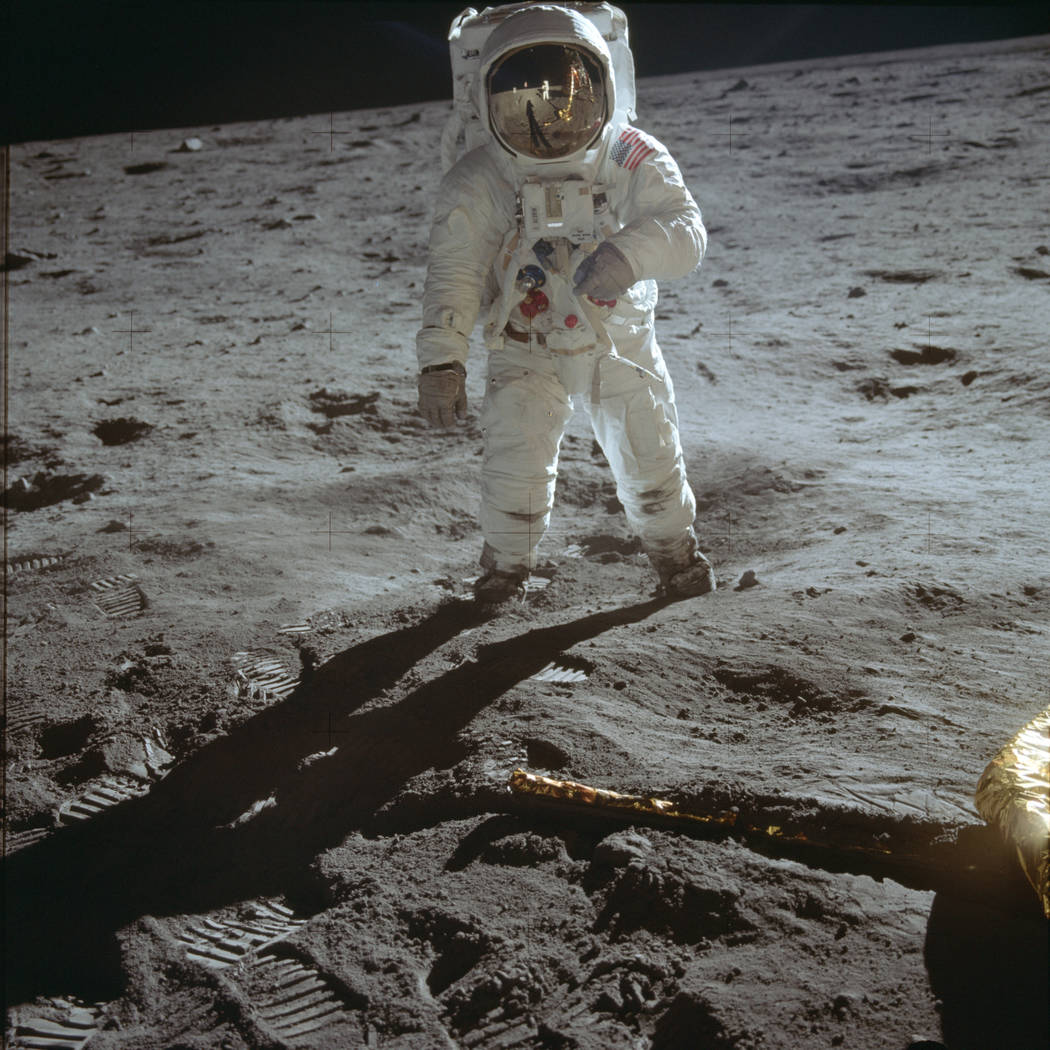In this July 20, 1969 photo made available by NASA, astronaut Buzz Aldrin, lunar module pilot, ...