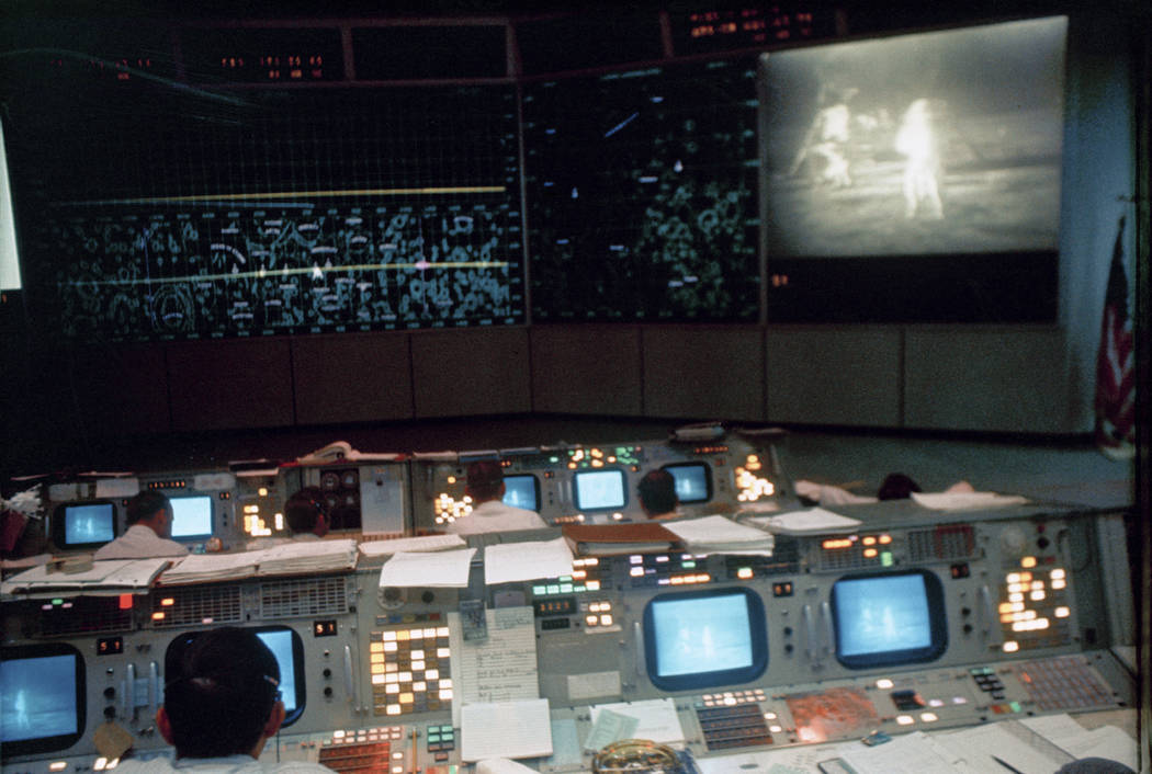 In this July 20, 1969 photo made available by NASA, flight controllers work in the Mission Oper ...