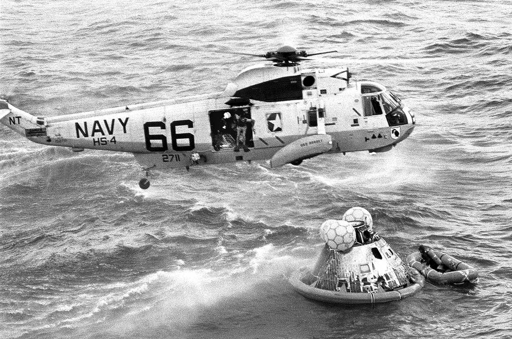 In this July 24, 1969 photo from the U.S. Navy, Navy UDT swimmer Clancy Hatleberg prepares to j ...