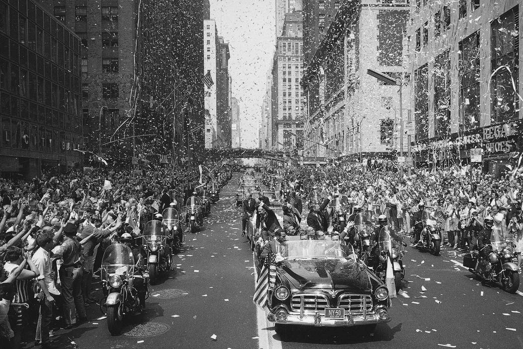In this Aug. 13, 1969 file photo, people line 42nd Street in New York to cheer Apollo 11 astron ...