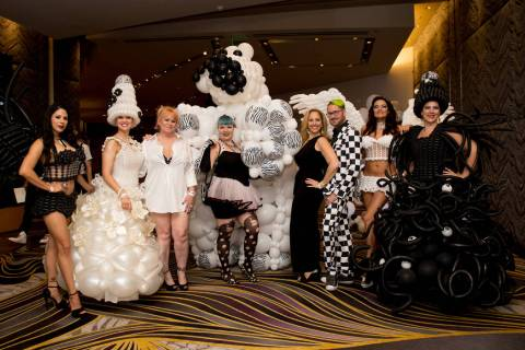 Attendees show off their outfits during Aid for AIDS of Nevada's (AFAN) 30th annual Black & Whi ...