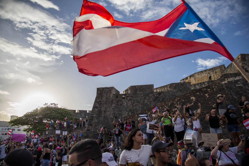 Demonstrators march against governor Ricardo Rosello, in San Juan, Puerto Rico, Wednesday, July ...