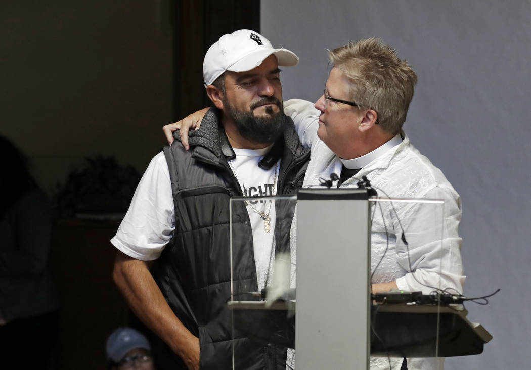 Jose Robles, left, is embraced by Gethsemane Lutheran Church Pastor Joanne Engquist inside Rive ...