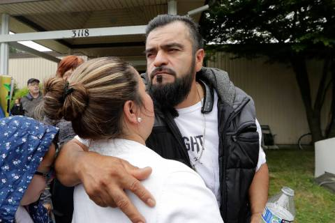 Jose Robles embraces his wife, Susana Robles, after leaving Riverton Park United Methodist Chur ...