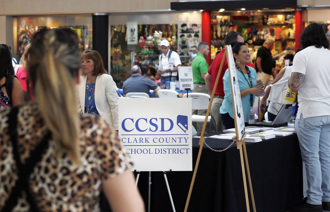 Individuals visit different booths during the annual Cox Back to School Fair at the Galleria at ...