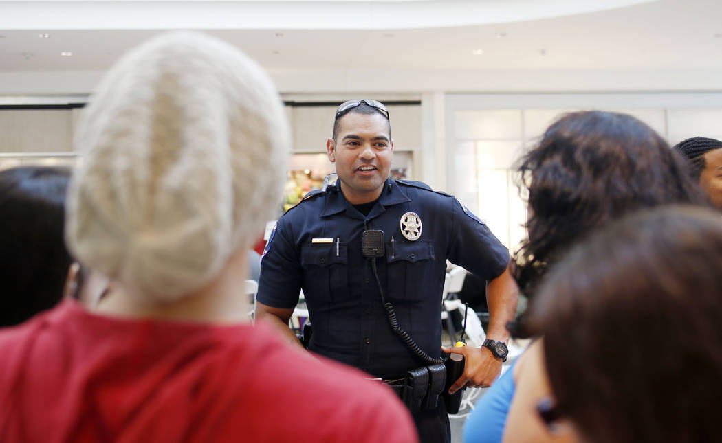 Clark County School District police officer Bernardo Abarca speaks with new CCSD students durin ...
