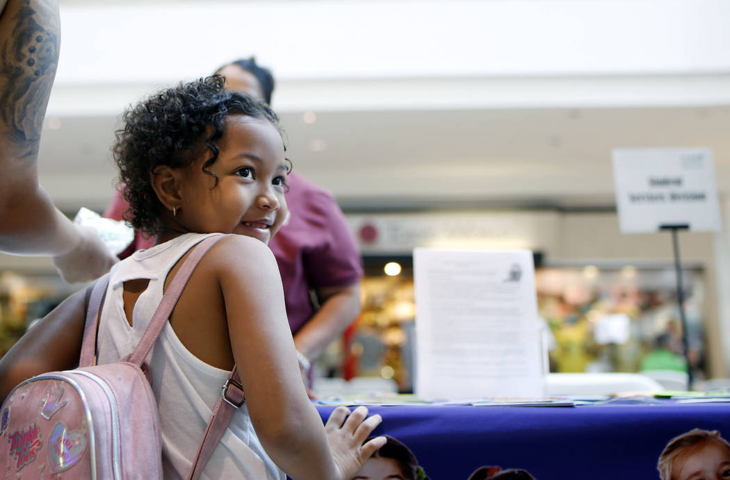 London Richey, 6, going into the first grade, attends the annual Cox Back to School Fair at the ...