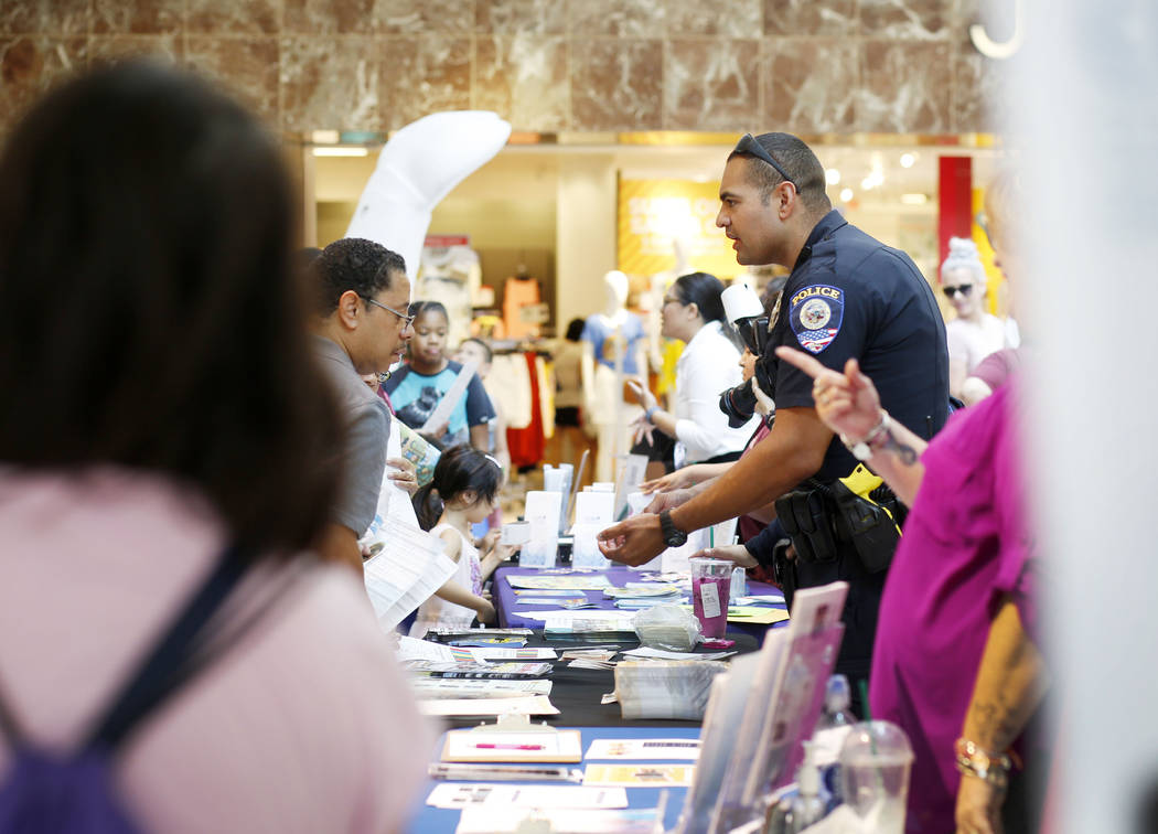 Individuals visit booths during the annual Cox Back to School Fair at the Galleria at Sunset ma ...